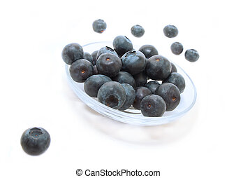 ripe big  blueberries in the plate on a white background
