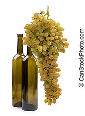 Ripe big bunch of grapes of sultana on white background with two bottles