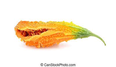 Ripe bitter melon with orange flesh, splitting open