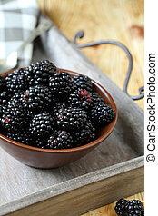 ripe blackberries in a bowl