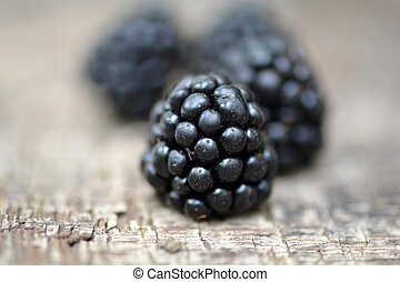 Ripe blackberry on a wooden background