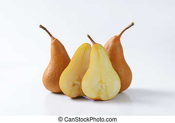 Ripe Bosc pears - European pears, whole and cut in halves