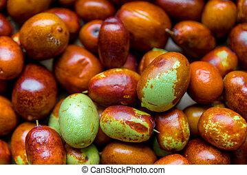 Ripe broun jujube chinese dates, close up.