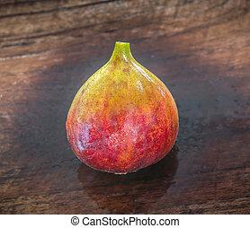ripe brown turkey figs on teak wooden