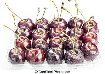 Ripe cherries hill on white background