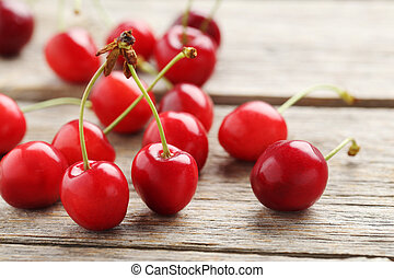 Ripe cherries on a grey wooden table