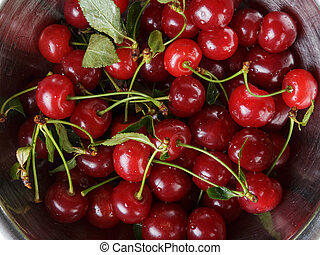 ripe cherries with stem and leaves