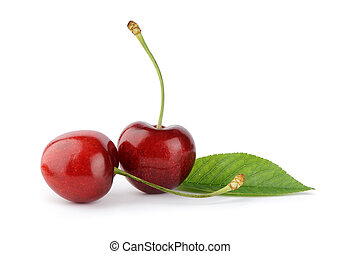 Ripe cherry berries with green leaf