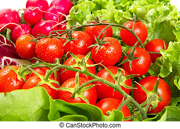 ripe cherry tomatoes on a white background