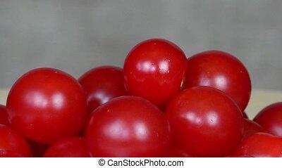 Ripe cherry tomatoes. Organic food. turntable anticlockwise...