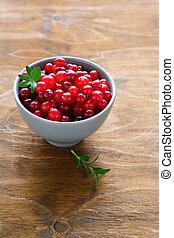 ripe cranberries in a bowl