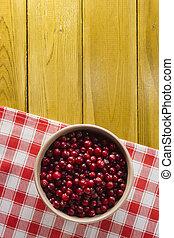 Ripe cranberries in a ceramic plate