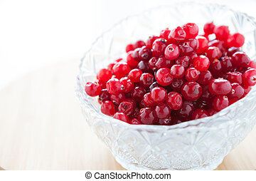 ripe cranberries in a glass bowl