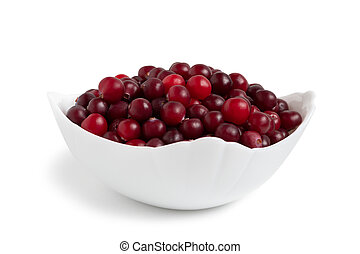 Ripe cranberries in a white ceramic bowl isolated on white background