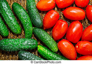 Ripe cucumbers and red tomatoes