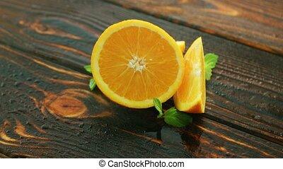 Ripe cut orange on table - Closeup shot of tasty juicy ripe...