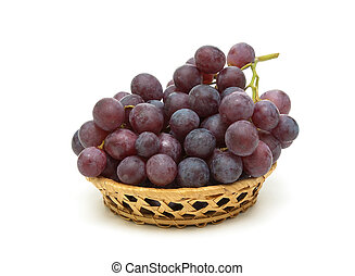 ripe dark grapes isolated on white background
