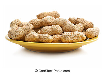 ripe dry nuts on a dish isolated