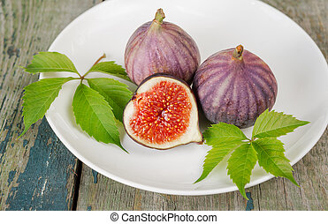 Ripe figs on a white plate