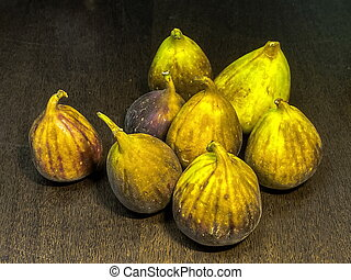Ripe figs on dark brown wooden table