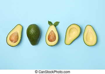 Ripe fresh avocado on blue background, top view
