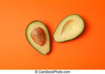 Ripe fresh avocado on orange background, top view
