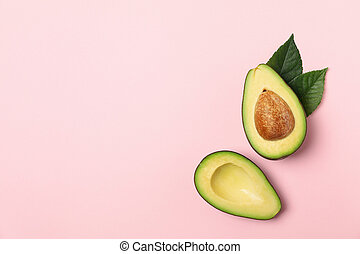Ripe fresh avocado on pink background, top view