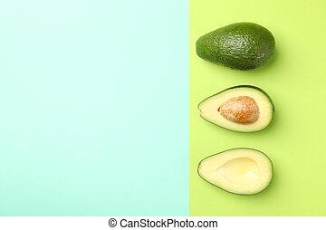 Ripe fresh avocado on two tone background, top view