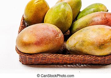 ripe fresh colorful mango in a basket