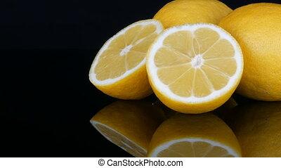 Ripe fresh juicy yellow lemon on black background - Ripe...