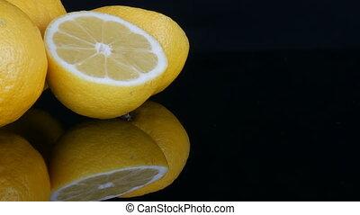 Ripe fresh juicy yellow lemon on black background