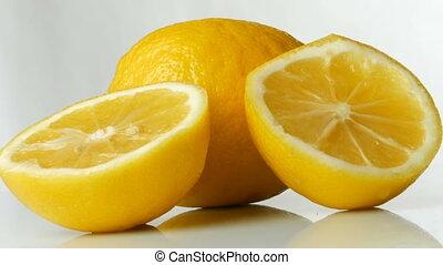 Ripe fresh juicy yellow lemon on white background. - Ripe...