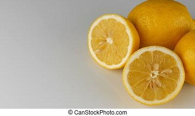 Ripe fresh juicy yellow lemon on white background.