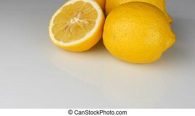 Ripe fresh juicy yellow lemon on white background rotate -...