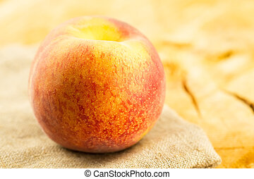 ripe fresh peaches on wooden background