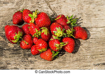 Ripe fresh strawberries on rustic wooden background. Top view
