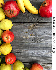 ripe fruit on a wooden background
