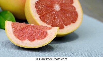 Ripe grapefruit close-up on wooden table background.