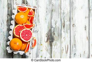 Ripe grapefruit in the box.