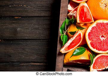 Ripe grapefruits in the box.