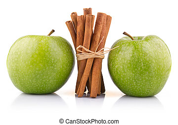 Ripe green apples with cinnamon sticks isolated