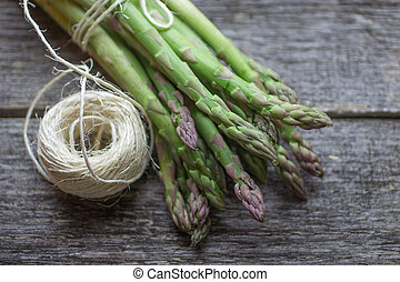 green asparagus - ripe green asparagus on a wooden...