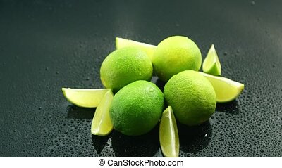 Ripe green limes on table