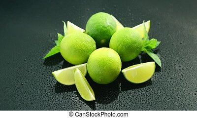 Ripe green limes on table - Closeup fresh bright green limes...