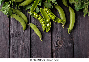 Ripe Green peas on wooden table. - Ripe Green peas on wooden...