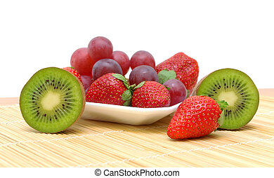 kiwi, strawberries and grapes on a white background