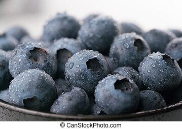 ripe juicy blueberries with dew drops, macro