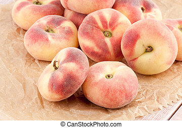 ripe juicy chinese flat peaches