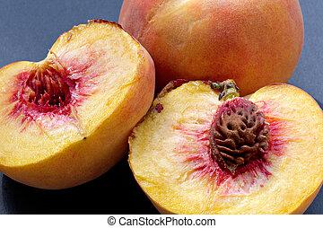 Ripe juicy fleshy cut peaches