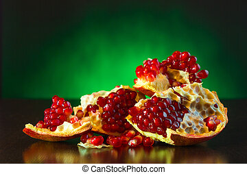 Ripe juicy fruit of the broken pomegranate